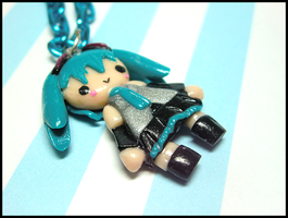 Tiny Miku Necklace by GrandmaThunderpants