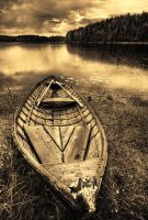 Wooden Boat In The Rain by Nitrok
