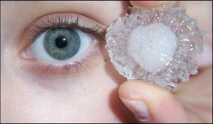 Green eye and ice cube by pety-ytep