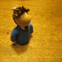 A tiny clay Tenth Doctor by ernieselephants