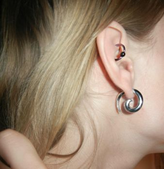 Ear gauges and rook piercing by KittiKristy