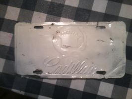 cadillac plate (before) by USCGCitasca