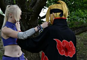 Ino and Deidara the classical hairfight by SniperSunny