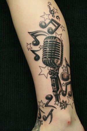 http://th02.deviantart.com/fs28/300W/i/2008/181/8/9/Music_Crazy_Micro__TaT_by_2Face_Tattoo.jpg