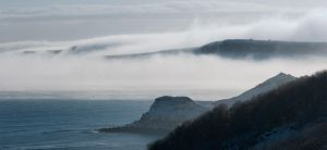 Mist rolling over the cliffs by BikeBoyPunk
