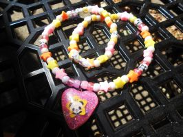 Pink n Yellow Starry Resin Panda Kandi necklace by Lutrasaura