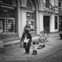 Musician in the Street by Freggoboy