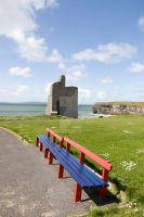 benches view of Ballybunion castle beach and cliff by morrbyte