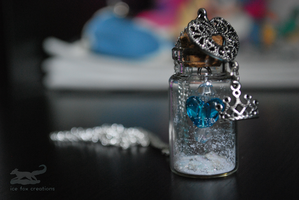 Frozen/Snow Queen-Inspired Glass Bottle Necklace by antarctic-storm