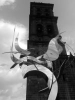 The Angel and the Left tower of the Cathedral by Kerochris