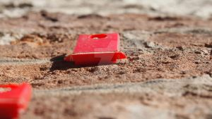 Odd red, plastic thing on the wall by PAHalny