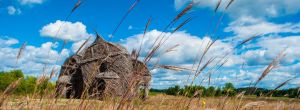 Stick House and Cumulus Clouds by KML032