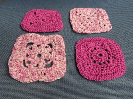 Four crocheted coasters by purplenotebooks
