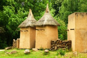 African adobe buildings by steppelandstock