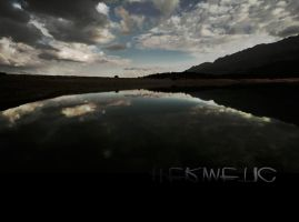 Heavy clouds, silent lake by Hermetic-Wings