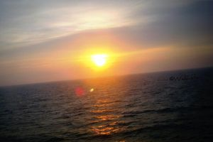 Sunset at the Sea by Wekuster