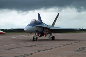 CF-18 under cloudy skies by tdogg115