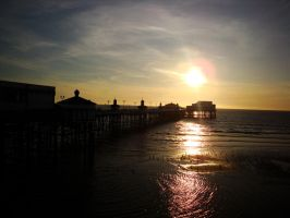sunset on the pier by Estruda