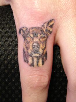PORTRAIT of DOG on FINGER by Mariotattoos