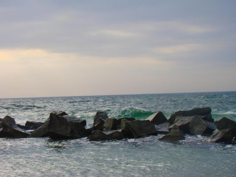 Mare- Rocks, Green Waves and sinking Sun by LuDa-Stock