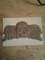Skull with wings by howardhowitzer