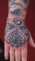 Freestyle monster hand tattoo by graynd