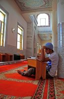 Reading Quran by iraqiguy