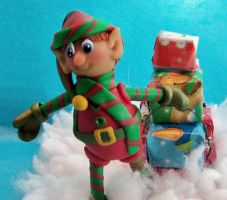 Elf with presents on sled sculpture by CreativeCritters