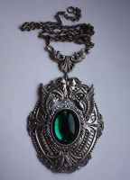 Green stone steampunk pendant by Pinkabsinthe