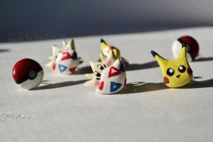 Pokemon earrings by Smikimimi