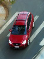 Red Kia Carens by broettonavarro