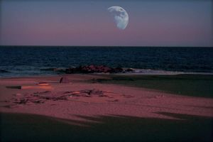 Moon on the beach by brokenphoto