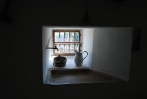 Old can water-tap and wooden pot by LimeStock