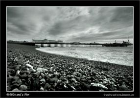 Pebbles and a Pier by Andrew-and-Seven