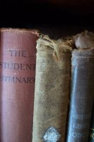Old tattered books by paintresseye