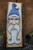 Completed blue swirlhat Santa relief carving by BradicalEYE