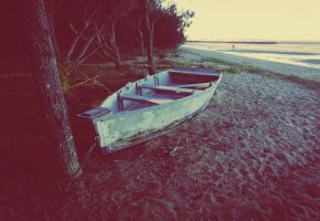 Boat by the beach by AbsurdWordPreferred
