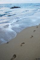 Foot prints on the sand by byra666