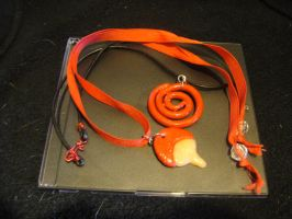 Uchiha and Uzumaki necklaces by ElleDontYouDare