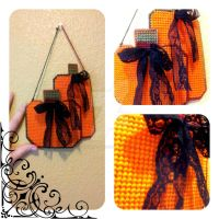 Lacy pumpkin wall hanging by ravenaudron