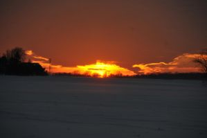 Sunset over a snowy field by CrazypersonA4
