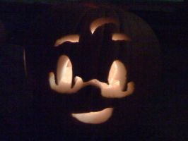 my pumpkin carved late by Canada960