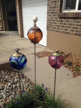 Glass and metal garden art by pontil