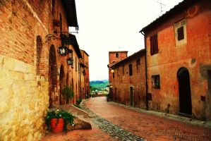 Street in medeival tuscan town by carnelianred