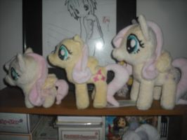 My Fluttershy Plush Family by SecludedOtaku