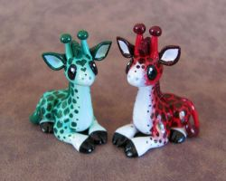 Red and green giraffe couple by DragonsAndBeasties