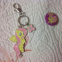 I  got Fluttershy keychain and badge at Hot Topic by Magic-Kristina-KW