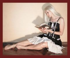 Alice reads a book 1 by Lisajen-stock