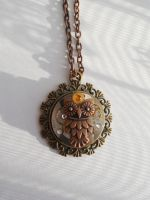 Steampunk necklace with mechanical owl by SteamJo
