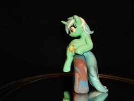 Lyra Laptop Hugger (side view) by DeadHeartMare